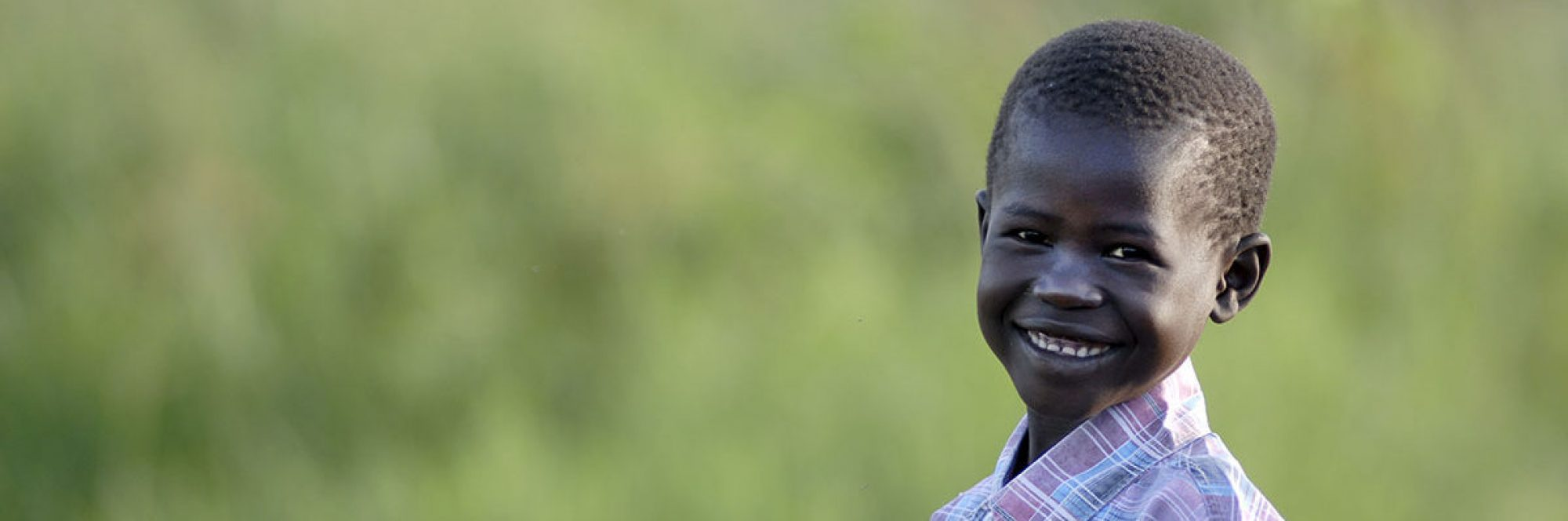 Child near the JRS compound in Lobone in Southern Sudan.